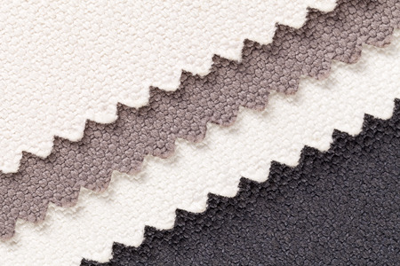 Background, composition of colored diagonal  stripes of serrated cotton fabric.place for text