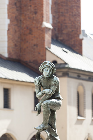 Figurine student, a copy of the form from the altar of Veit Stoss,  fountain in the square of St. Marys, Krakow, Poland
