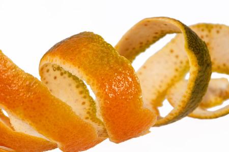 Peeled mandarine skin isolated on white background, close up. Stock Photo
