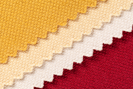diagonal stripes: Composition of colored diagonal stripes of serrated cotton fabric , place for text