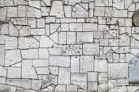 remuh: Wailing Wall at Remuh Cemetery  built with fragments of Jewish tombstones destroyed by the Nazis, Krakow, Poland.