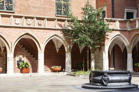 university fountain: Courtyard of Collegium Maius, Old Town, Krakow, Poland.