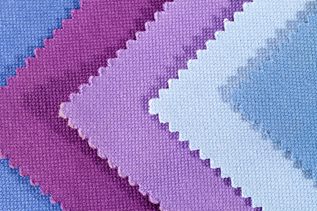 entanglement: Composition of colored pieces of serrated cotton fabric. Stock Photo