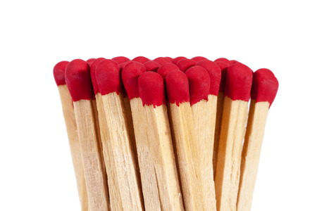Heap of matches with rad heads isolated on white background, close up