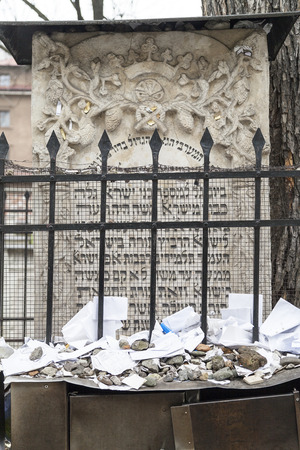 remuh: KRAKOW, POLAND - MARCH 20, 2116 : Tombstone (matzeva) of  Moses on Remuh Cemetery with lot of kvitlech. Old Jewish Cemetery of Krakow  is an inactive Jewish historic cemetery established in 1535.It is located next to the 16th-century Remah Synagogue. Editorial