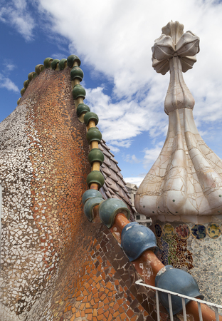 Barcelona, Spain - May 11,2016 : Casa Batllo,  housetop , chimneys with ceramic mosaic. Building  redesigned in 1904 by Gaudi located in the center of Barcelona, it  is on the UNESCO World Heritage Site. Stock Photo