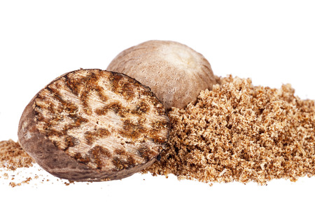 Nutmeg ,whole,  half and ground on white background, close up. Stock Photo