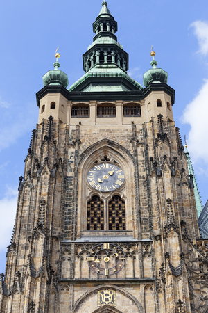 14th century St. Vitus Cathedral , facade, tower with clock, Prague, Czech Republic.  It is a Roman Catholic metropolitan cathedral in Prague, the seat of the Archbishop of Prague. Stock Photo