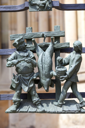 14th century St. Vitus Cathedral ,figures of Golden Gate fence, relief, Prague, Czech Republic.  It is a Roman Catholic metropolitan cathedral in Prague, the seat of the Archbishop of Prague. Editorial
