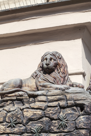 Relief on facade of old building, wooden lion , Prague, Czech Republic, Europe