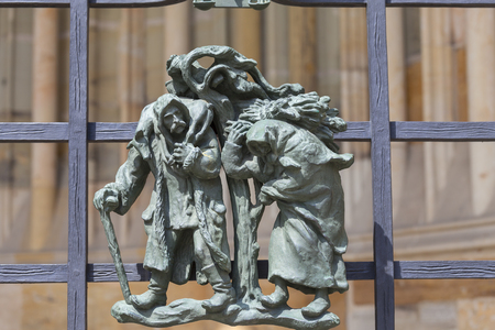 14th century St. Vitus Cathedral ,details of Golden Gate fence ,small figures,  Prague, Czech Republic. It is a Roman Catholic metropolitan cathedral in Prague, the seat of the Archbishop of Prague.