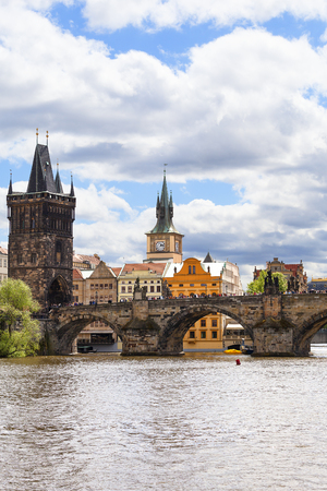 PRAGUE, CZECH REPUBLIC - MAY 2, 2017 : Charles Bridge on Vltava river in sunny day. Its construction started in 1357 under the auspices of King Charles IV. It is the most popular bridge in Prague, there are always many tourists. Editorial