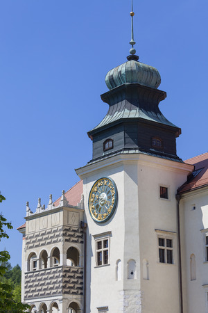 14th century defense Castle Pieskowa Skala , clock tower, near Krakow, Poland. Located in Ojcowski National Park, is one of the best-known examples of a defensive Polish Renaissance architecture Editorial