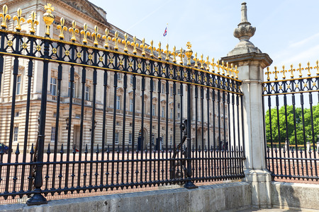 Buckingham Palace, details of decorative fence, London, United Kingdom. Palace is the London residence and administrative headquarters of the reigning monarch of the United Kingdom