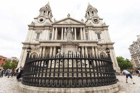 LONDON, UNITED KINGDOM - JUNE 22, 2017: 18th century St Paul Cathedral and statue of Queen Anne. It is an Anglican monumental cathedral, the seat of the Bishop of London Editorial