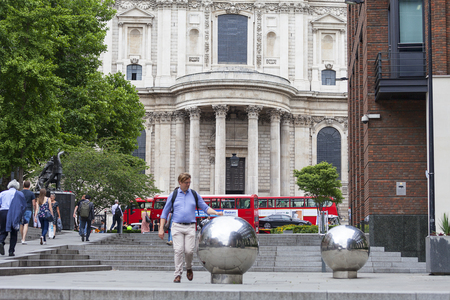st: LONDON, UNITED KINGDOM - JUNE 22, 2017: 18th century St Paul Cathedral, street view, London, United Kingdom.  It is an Anglican monumental cathedral, the seat of the Bishop of London. View Editorial