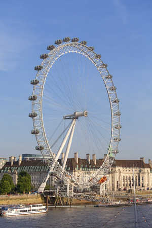 LONDON, UNITED KINGDOM - JUNE 21, 2017: View on London Eye on a sunny day. It was erected in 1999, is the most popular paid tourist attraction in the UK with over 3.75 million visitors annually Editorial
