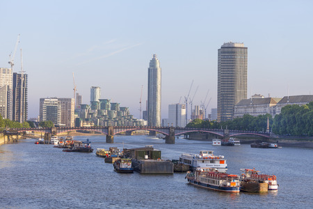 LONDON, UNITED KINGDOM - JUNE 22, 2017: View of the River Thames and modern glazed office buildings. As of 2017, there are 17 skyscrapers in London that reach a roof height of at least 150 meters