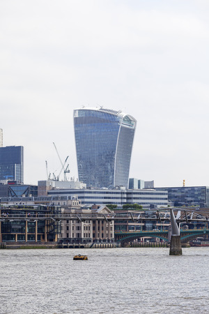 LONDON, UNITED KINGDOM - JUNE 22, 2017: Millennium Bridge and modern office buildings, 20 Fenchurch.  As of 2017, there are 17 skyscrapers in London that reach a roof height of at least 150 meters