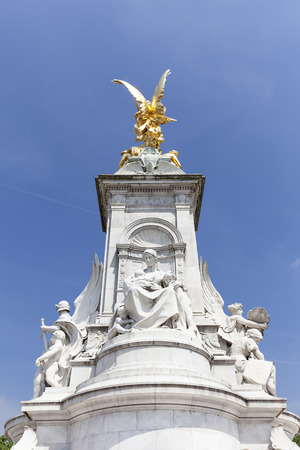 Queen Victoria Memorial in front of the Buckingham Palace, London, United Kingdom.  The monument was unveiled in 1911, made of 2,300 tons of gleaming white marble