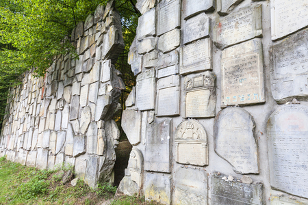 jewish: Jewish cemetery in Kazimierz Dolny, Czerniawy, Poland. Symbolic Wailing Wall built of tombstones destroyed by German Nazis during World War II. Stock Photo