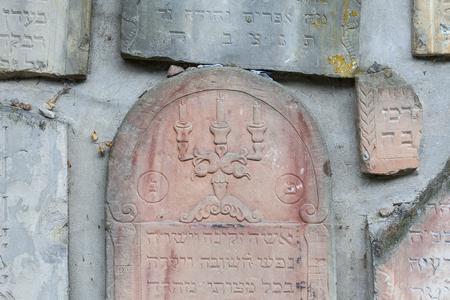 nazis: Jewish cemetery in Kazimierz Dolny, Czerniawy, Poland. Symbolic Wailing Wall built of tombstones destroyed by German Nazis during World War II. Stock Photo