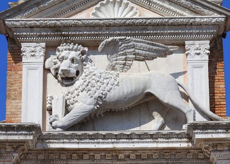 Venetian Arsenal, old shipyard stone lion, Venice, Italy. Construction of the Arsenal began in the 12th century, it was the largest industrial complex in Europe before the Industrial Revolution Stock Photo