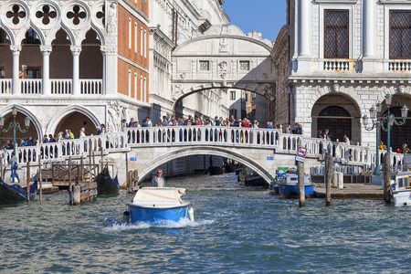VENICE, ITALY - SEPTEMBER 21, 2017: Sea view on stone bridge Ponte della Paglia. The bridge is always surrounded by tourists, with the best view of the Bridge of Sighs