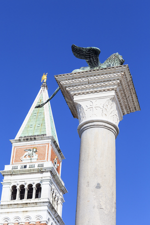 Column of San Marco and St Marks Campanile on Piazza San Marco , Venice, Italy. Stock Photo