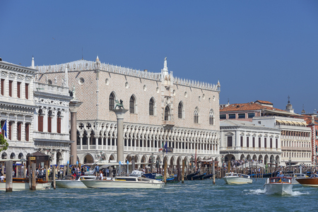 VENICE, ITALY - SEPTEMBER 22, 2017: Sea view on Doges Palace (Palazzo Ducale) and Column of San Marco on St Marks Square. The palace was the residence of the Doge of Venice,  the museum is currently located here Stock Photo