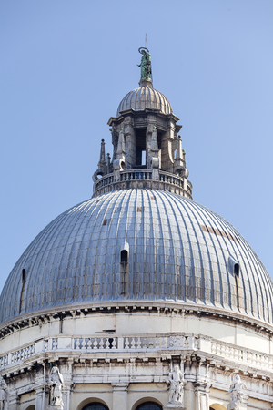Baroque  church Santa Maria della Salute, dome, Venice, Italy. It was built in the 17th century as a votive thanksgiving after the plague epidemic 写真素材