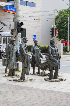 WROCLAW - POLAND, JUNE 13, 2017 : The Monument of An Anonymous Passerby, Transition, sculptures of people by Jerzy Kalina. Installation located at the intersection of streets in the city center since 2005 Editorial