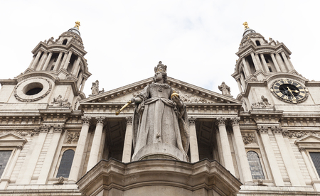18th century St Paul Cathedral and statue of Queen Anne, London, United Kingdom.  It is an Anglican monumental cathedral, the seat of the Bishop of London
