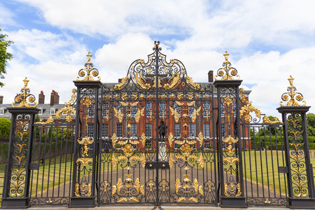 LONDON, UNITED KINGDOM - JUNE 23, 2017: Kensington Palace set in Kensington Gardens, decorative gate.  It has been a residence of the British Royal Family since the 17th century and Queen Victorias b