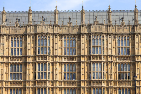 Palace of Westminster, parliament, facade, London,United Kingdom, England.  The Palace lies on the north bank of the River Thames in the City of Westminster, in central London