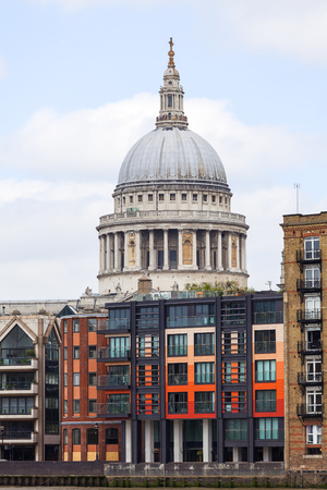 LONDON, UNITED KINGDOM - JUNE 22, 2017: 18th century St Paul Cathedral, view from the river Thames. It is an Anglican monumental cathedral, the seat of the Bishop of London