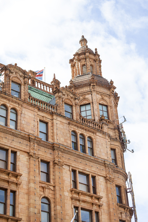 LONDON, UNITED KINGDOM - JUNE 23, 2017: Harrods , luxury department store on Brompton Road. 7-storey building built in 1905, has 330 departments covering 90,000 m2 of retail space Editorial