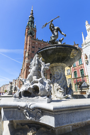 GDANSK, POLAND - JUNE 5, 2018: 17th century Neptunes Fountain Statue at Long Market Street by the entrance to Artus Court.
