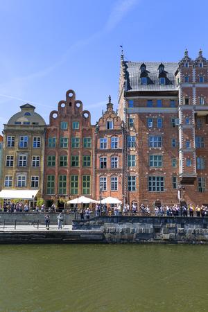 GDANSK, POLAND - JUNE 5, 2018: Long Embankment street, boulevards on the Motława River, port for tourist ships