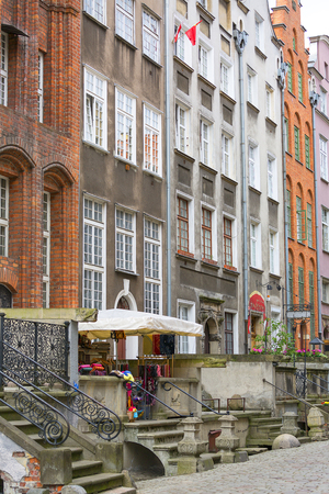 GDANSK, POLAND - JUNE 5, 2018: Mariacka street, typical decorative stoop with stone stairs, fronts of colorful tenements, Main city