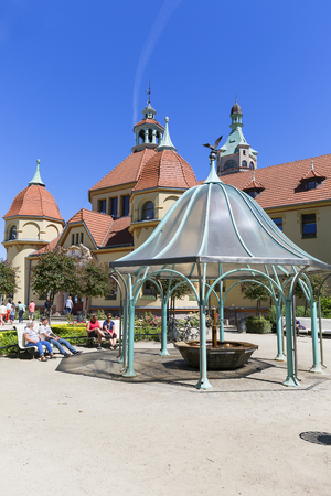 SOPOT, POLAND - JUNE 6, 2018: Balneological Department with fountain by the Baltic Sea and Sopot pier