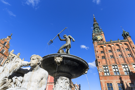 17th century Neptunes Fountain Statue at Long Market  Street by the entrance to Artus Court, view on Town Hall