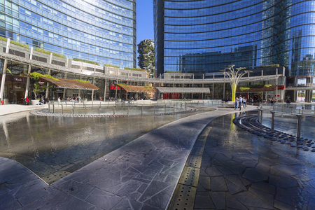MILAN, ITALY - SEPTEMBER 29, 2018: Modern glazed office building, business district, Porta Nuova, Piazza Gae Aulenti. It one of the top new attractions in Milan