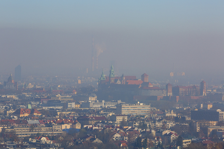 Dense smog over the city, air pollutant, aerial view of the old town Krakow, Wawel Castle, Poland