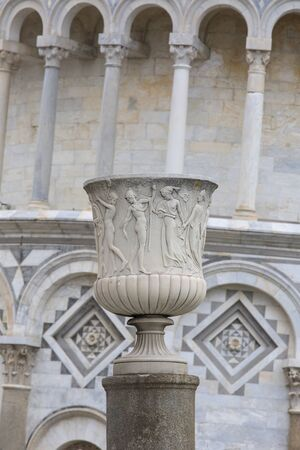 Decorative column on the background of Leaning Tower of Pisa and Pisa Cathedral, Piazza del Duomo