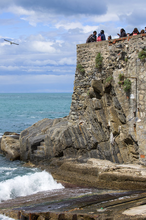 RIOMAGGIORE, CINQUE TERRE - ITALY, MAY 12, 2019: View on seaside and turquoise color of water, Riviera di Levante Editorial