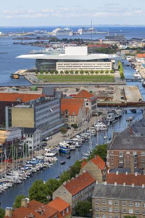 COPENHAGEN, DENMARK - JUNE 22, 2019 : Aerial view on the city, neo futurism Copenhagen Opera House. It is located on the island of Holmen in central Copenhagen