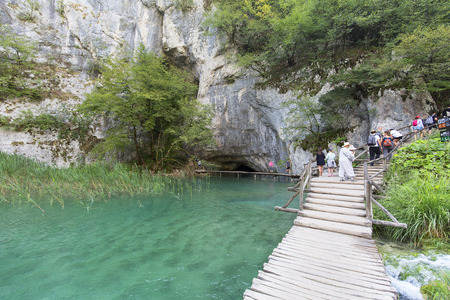PLITVICE LAKES, CROATIA - SEPTEMBER 2, 2019: Plitvice Lakes National Park, a miracle of nature, people on a wooden path