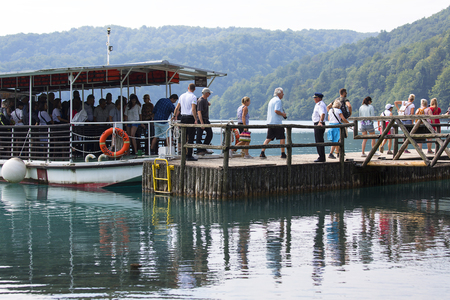 PLITVICE LAKES, CROATIA - SEPTEMBER 2, 2019: Plitvice Lakes National Park, a miracle of nature, visiting people on the ship