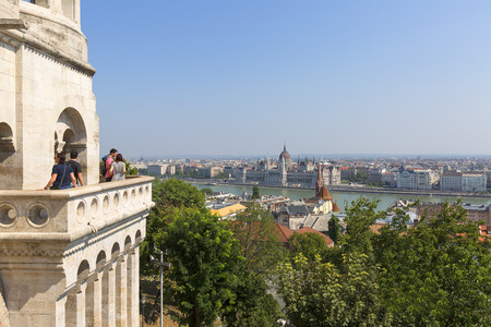 BUDAPEST, HUNGARY - SEPTEMBER 1, 2019: Fisherman Bastion, view on gothic Hungarian Parliament Building